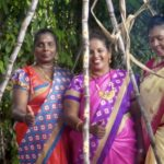 Pongal, indisches Erntedankfest in George Town, Malaysia. Frauen in bunten Saris.